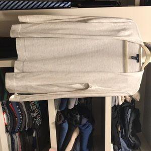 Cream long sleeved cardigan.